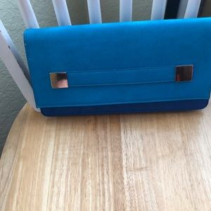Clutch bag, turquoise leather and blue suede